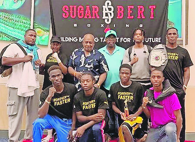 TEAM BAHAMAS at the Sugar Bert Boxing Tournament. Kneeling (l-r) are Lennox Boyce, Ronald Woodside, Patrick Joseph and Jovan Johnson. Standing are Keishno Major, Elizabeth Hutchinson, Wellington Smith, Vincent Strachan, Keith Major Jr and Carl Hield.