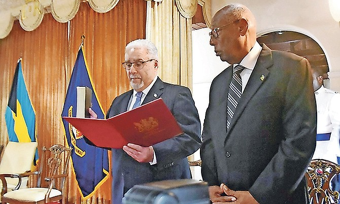 Brian Moree, QC, is sworn in as Chief Justice at Government House. Looking on is Cornelius A Smith, Deputy to the Governor General. Photo: Shawn Hanna/Tribune Staff