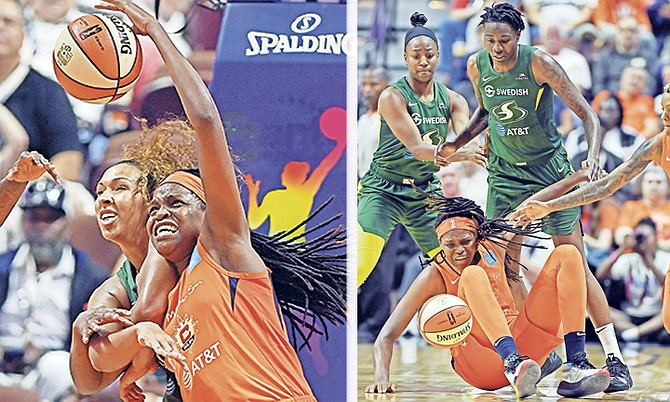 LEFT: Connecticut Sun centre Jonquel Jones is fouled fighting for a rebound with Seattle Storm centre Mercedes Russell, back, on Sunday at Mohegan Sun Arena.