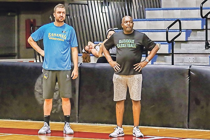 Coach Chris DeMarco stands next to Mario Bowleg. Photos by John Marc Nutt