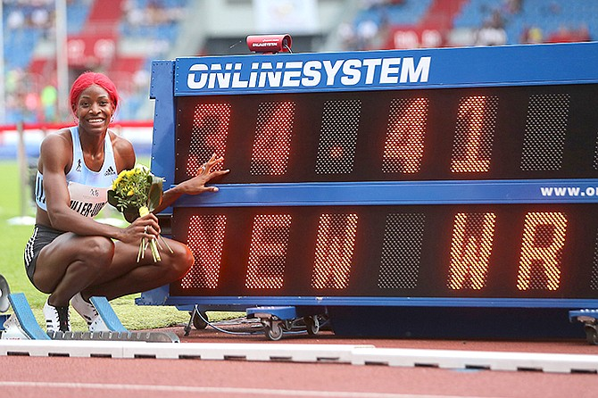 Shaunae Miller-Uibo celebrates after she won the women's 300 metres event in a new world record, at the Golden Spike athletics IAAF World Challenge in Ostrava, Czech Republic, Thursday. (Jaroslav Ozana/CTK via AP)