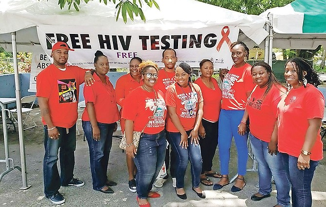 Volunteers from the Ministry of Health offer free HIV/AIDS testing at the 2018 National Testing Day event. The confidential process is part of efforts to encourage more persons to get tested and know their status. (Photo courtesy of HIV/AIDS Center MOH-BAH)