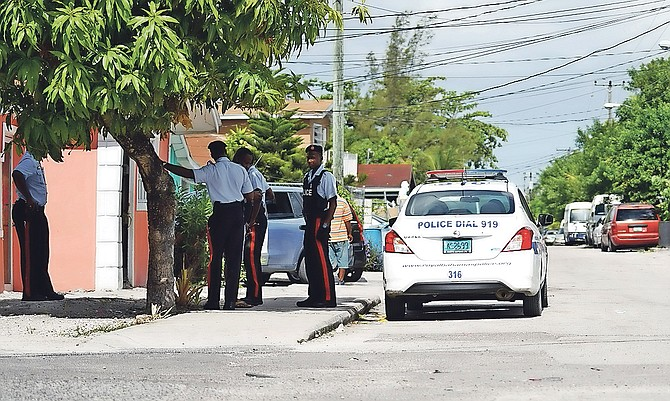 Police conduct door-to-door enquiries in Montel Heights on Sunday. Photo: Terrel W Carey/Tribune staff