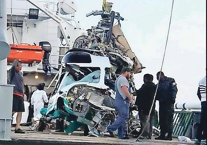 The helicopter after it was brought to the surface. (©The Tribune)