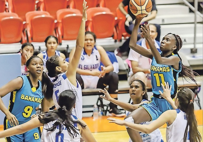Antonicia Moultrie shoots over El Salvador players during the Centrobasket U17 Championships for Women in San Juan, Puerto Rico.