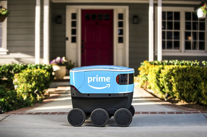 A self-driving delivery robot that Amazon is calling Scout. Amazon is expanding the use of its self-driving delivery robots to a second state. (Amazon via AP, File)