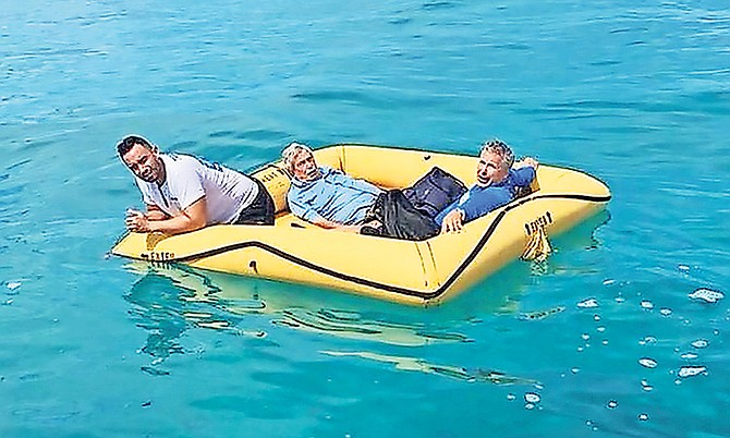 The three Americans who crash-landed near Cat Cay yesterday, afloat in a life raft.
