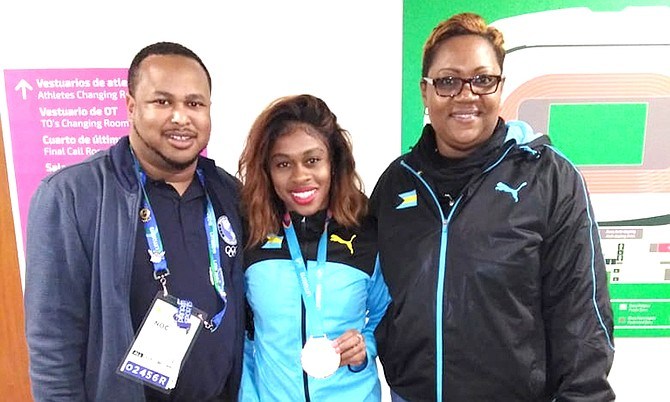 Pan Am women's 200m bronze medalist Tynia Giather is flanked by BOC secretary general Derron Donaldson and track and field manager Dawn Woodside-Johnson in Lima, Peru.