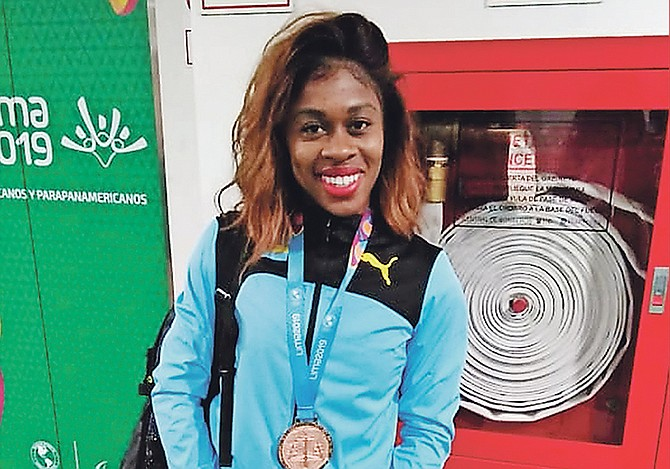 Tynia Gaither with her bronze medal.
