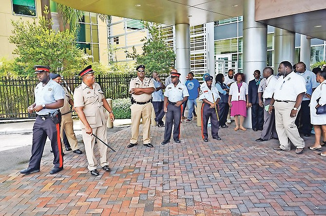 The strike by junior doctors yesterday being monitored by police officers. The Bahamas Doctors Union said more than 400 junior doctors took part in the action.