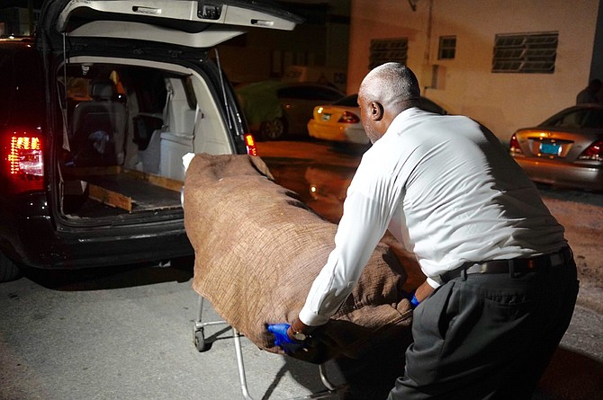The body is removed from the scene off Cowpen Road on Wednesday night. Photo: Terrel W Carey Sr/Tribune staff