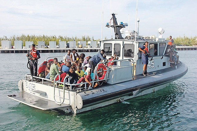 Haitian migrants entering the RBDF Base aboard patrol craft P-45. Photo: Chief Petty Officer Jonathan Rolle