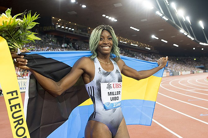 Shaunae Miller-Uibo reacts after winning the women's 200m race, during the Weltklasse IAAF Diamond League international athletics meeting in the stadium Letzigrund in Zurich, Switzerland, Thursday. (Jean-Christophe Bott/Keystone via AP)