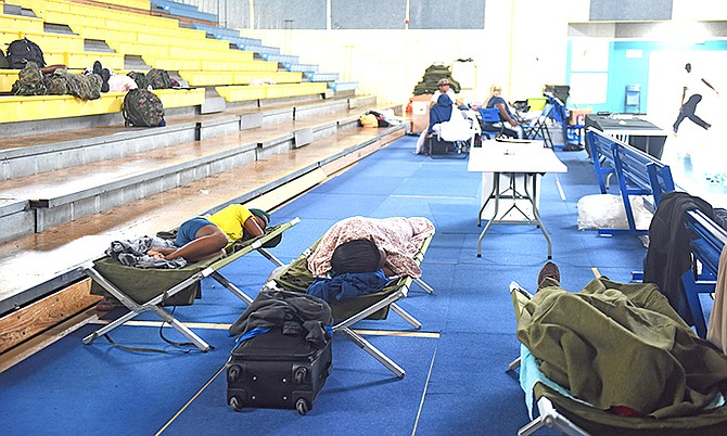 Residents taking shelter in Kendal Isaacs Gym. Photo: Shawn Hanna/Tribune staff