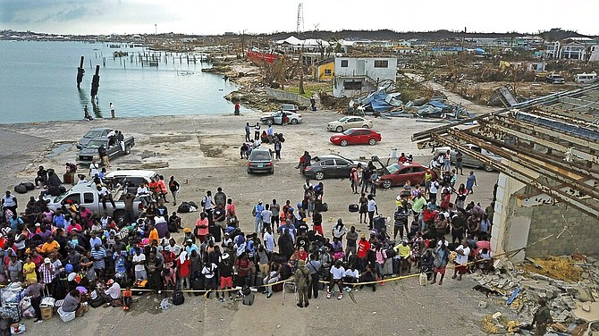 Evacuees gather at Marsh Harbour Port in Abaco, Friday. (Al Diaz/Miami Herald via AP)