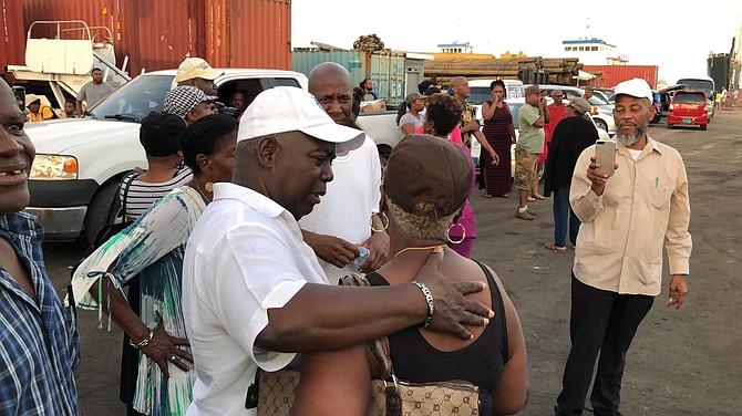 PLP Leader Philip 'Brave' Davis greets evacuees at Potter's Cay Dock.
