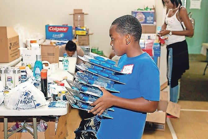Volunteers at NPCC organising and packing donated goods for hurricane relief. Photos: Donavan McIntosh