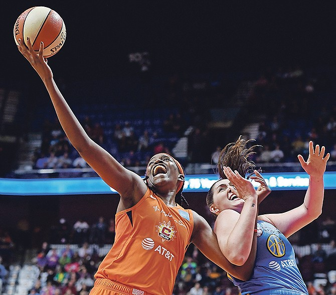 Connecticut Sun centre Jonquel Jones beats Chicago Sky centre Stefanie Dolson to a rebound last week Friday. (AP)