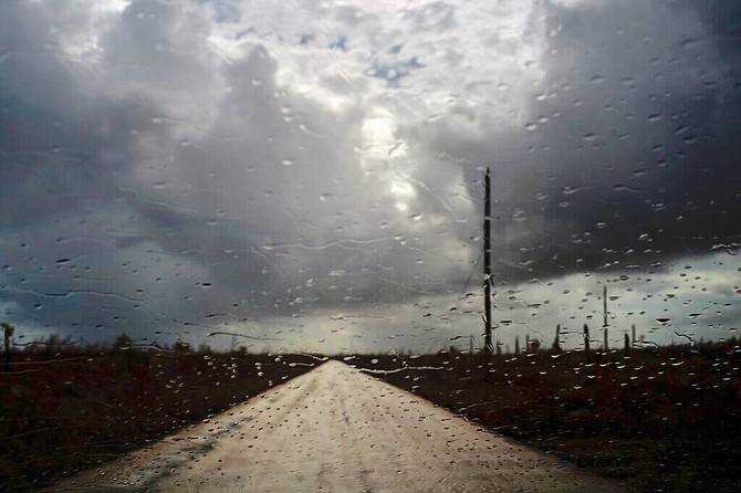 Rain falls on the windshield of a car in McLean's Town, Grand Bahama, Friday. (AP Photo/Ramon Espinosa)