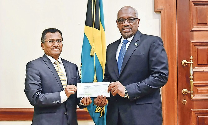 India High Commissioner M Sevala Naik presented a $1m donation to Prime Minister Dr Hubert Minnis for storm relief yesterday.