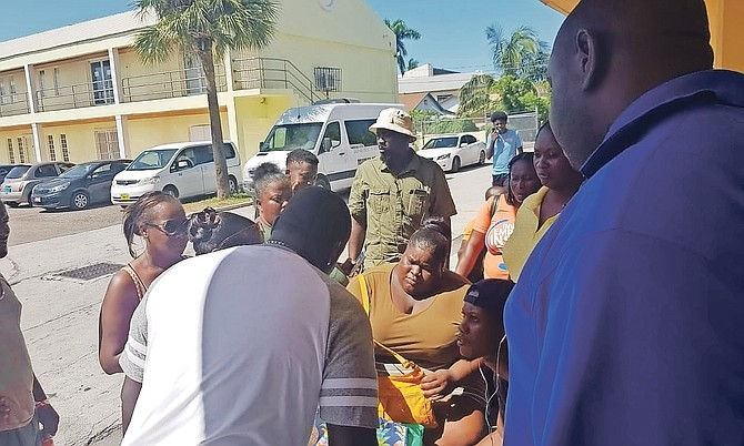 "People were left waiting for hours yesterday at both the Department of Social Services and the Registrar General's Department, as government services struggled to cope with the number of people in need of help after Hurricane Dorian. Among those waiting was Alesha McNeill, pictured seated centre, who lost the roof of her home in Fortune Bay, Grand Bahama, who had obtained a copy of her police record and a job application form, who said: ""I just need clothes because I lost everything in the storm. I need a job. I just need help.""  Photo: Rashad Rolle/Tribune Staff"