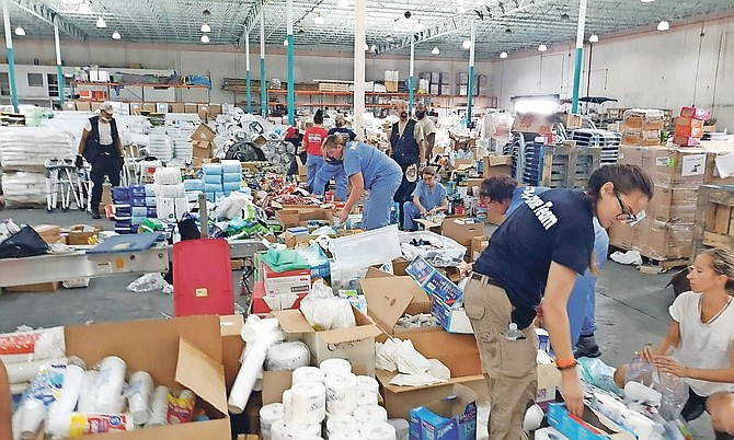 Volunteers at Freeport Ship Services Warehouse on Saturday. Photo: Lisa Davis/BIS