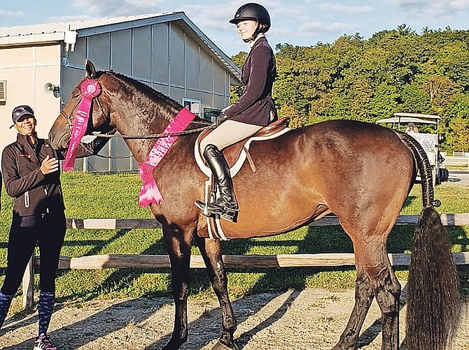 "Trainer Erika Adderley-Coello enjoys a smile with Elle O'Brien, who placed 12th out of 76 riders in the Marshall and Sterling 2' 6"" Children's Medal Final in Saugerties, New York. O'Brien is shown riding My Way, owned by Stacey Vertullo."