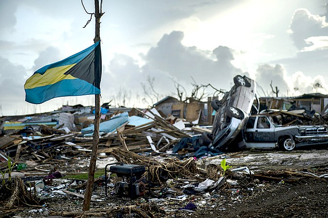 A Bahamas flag flies tied to a sapling, amidst the rubble left by Hurricane Dorian in Abaco in September. (AP Photo/Ramon Espinosa)