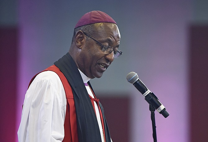 Anglican Bishop Laish Boyd speaks at Wednesday's service. Photo: Shawn Hanna/Tribune staff