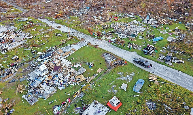 In this picture from September 8th, a road cuts through the rubble of homes that belong to the same family, destroyed by Hurricane Dorian in Rocky Creek, East End, Grand Bahama. Photo: Ramon Espinosa/AP
