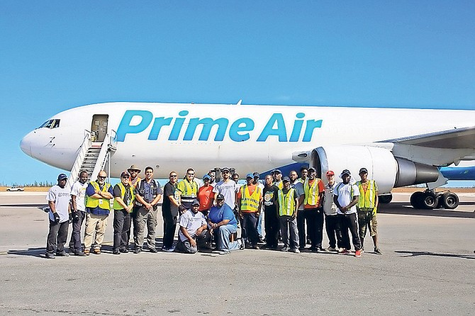 An Amazon Air flight arrives at Grand Bahama International Airport, bringing supplies to assist the Grand Bahama Disaster Relief Foundation.