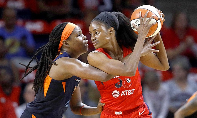 Washington Mystics forward LaToya Sanders, right, protects the ball from Connecticut Sun forward Jonquel Jones in the first half of Game 1 of basketball's WNBA Finals, Sunday. (AP Photo/Patrick Semansky)