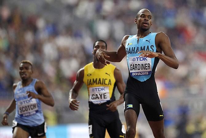 Steven Gardiner finishes first in his men's 400 metre semifinal at the World Athletics Championships in Doha, Qatar. (AP Photo/Petr David Josek)