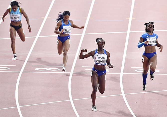 Tynia Gaither, Dezerea Bryant, of the United States, Dina Asher-Smith, of Great Britain, Brittany Brown, of the United States, from left, compete in the women's 200 metre finals at the World Athletics Championships in Doha, Qatar, Wednesday. (AP Photo/Martin Meissner)