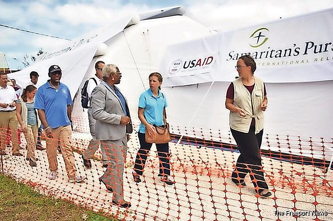 Debbie Wasserman Schultz, centre, being shown around the Samaritan Purse site.