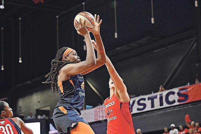 Connecticut Sun forward Jonquel Jones, left, goes to the basket against Washington Mystics forward Elena Delle Donne, right, in the first half of Game 2 of the WNBA Finals last night in Washington. (AP Photo/Nick Wass)