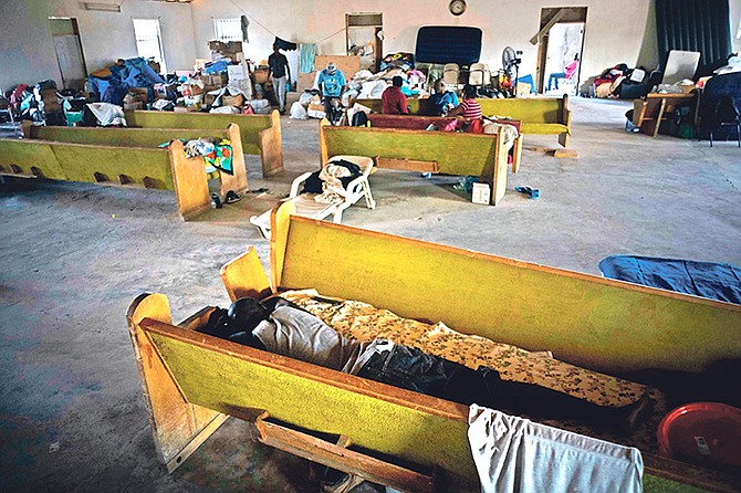 Haitian migrants displaced from their homes destroyed by Hurricane Dorian rest in a church shelter in Abaco on Saturday. Photo: Ramon Espinosa/AP
