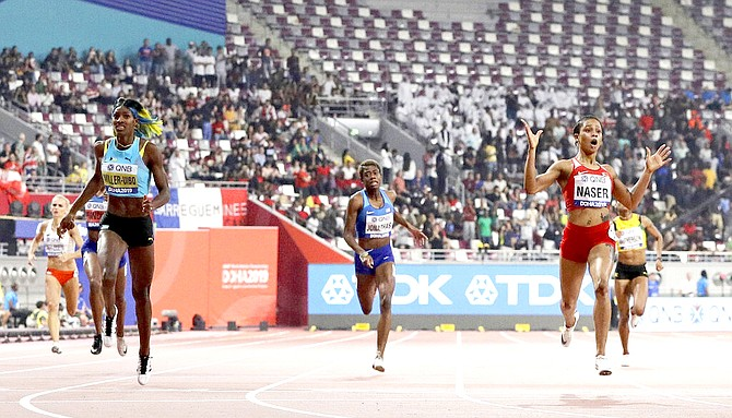 Salwa Eid Naser, of Bahrain, right, wins the gold medal in the women's 400 metre final ahead of Shaunae Miller-Uibo at the World Athletics Championships in Doha, Qatar. (AP Photo/Petr David Josek)