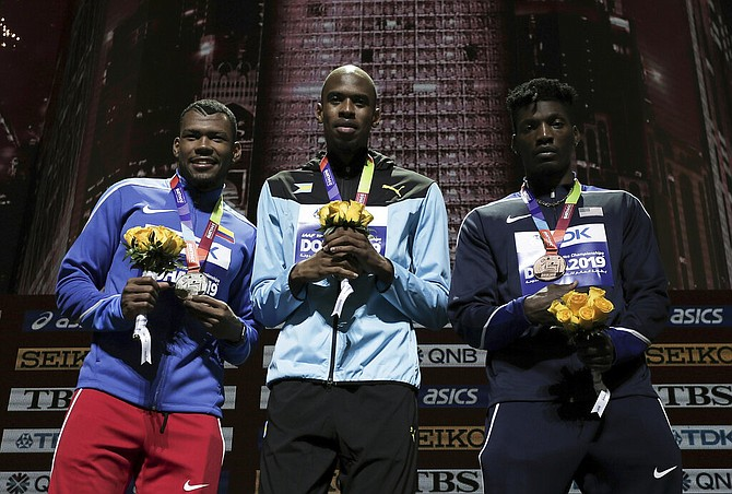 Steven Gardiner, gold, Anthony José Zambrano of Colombia, silver, and Fred Kerley, of the United States, bronze, during the medal ceremony for the men's 400m at the World Athletics Championships in Doha, Qatar, Saturday. (AP Photo/Nariman El-Mofty)