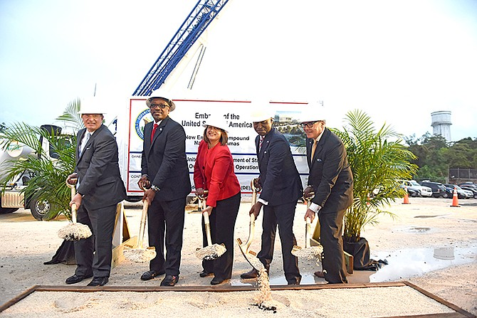 AT the groundbreaking, from left, are: Addison Davis, Director of the Bureau of Overseas Buildings Operations; Prime Minister Dr Hubert Minnis; Stephanie Bowers, Charge D'Affaires; Darren Henfield, Minister of Foreign Affairs and Jim Schaefer, American Chamber of Commerce of The Bahamas President. Photos: Shawn Hanna/Tribune Staff