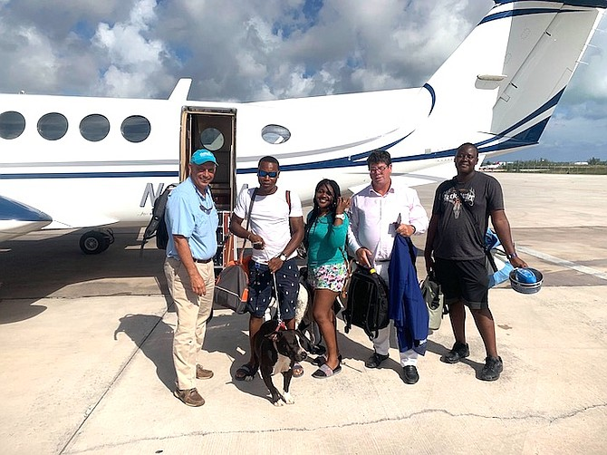 Doug takes this Abaco family and their dog to Nassau on his plane just after Hurricane Dorian.