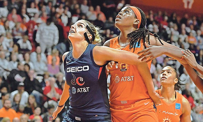 Washington Mystics' Elena Delle Donne, left, and Connecticut Sun's Jonquel Jones battle for position under the basket during the first half in Game 3 of the WNBA Finals on Sunday in Uncasville, Connecticut.