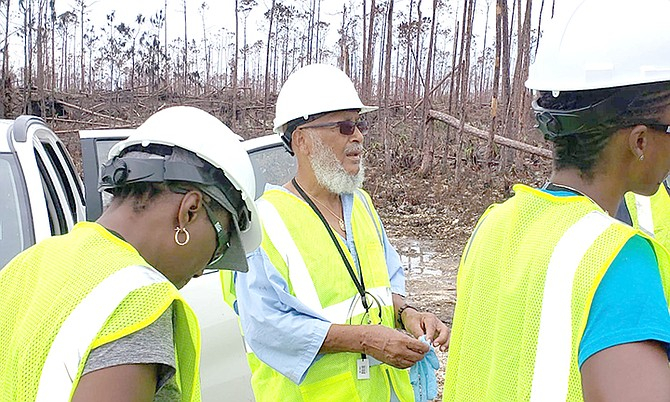 Human rights and environmental activist Joseph Darville and Rashema Ingraham of Save the Bays and Waterkeepers Bahamas tour Equinor spill site in East End on Tuesday.