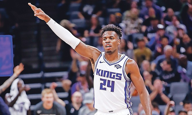 Sacramento Kings guard Buddy Hield celebrates after teammate Bogdan Bogdanovic scored a three-point basket during the first quarter of a preseason game against the Phoenix Suns in Sacramento, California, on October 10.  (AP Photo/Rich Pedroncelli)