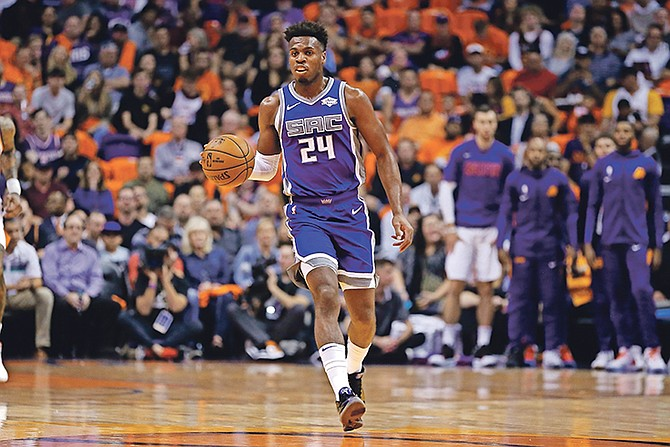Sacramento Kings guard Buddy Hield dribbles in the first half against the Phoenix Suns on Wednesday night in Phoenix.