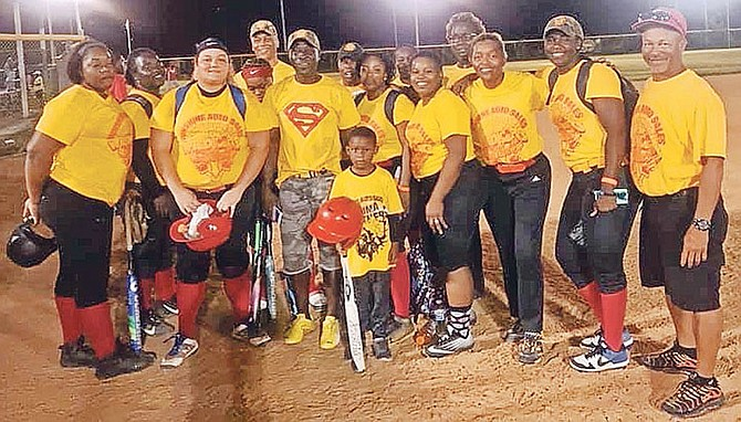 Champions Sunshine Auto Wildcats and sponsor Deanza 'Sonny' Cox pose for a photo after their victory. Photos courtesy of the Bahamas Softball Federation