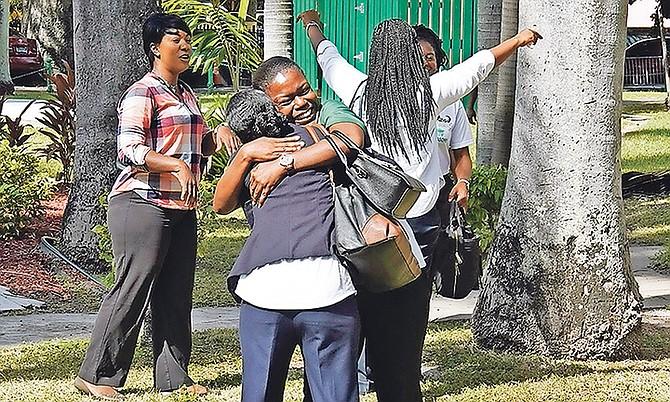 Teachers celebrate their win. Photo: Terrel W. Carey Sr/Tribune Staff