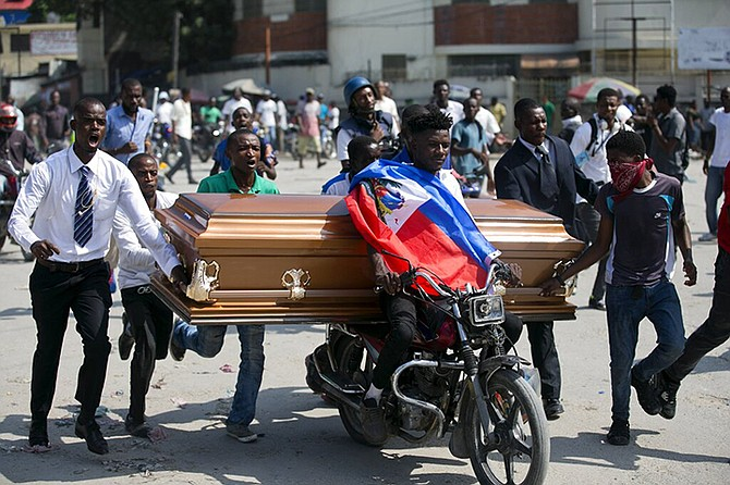 Family and friends transport the coffin that contain the remains of a protester who was recently killed, in Port-au-Prince, Haiti, Tuesday. (AP)