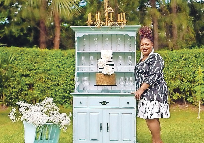 Gina Sands shows off some of her vintage pieces available for rental.  (Photos/Rashad Smith/RS Photography)