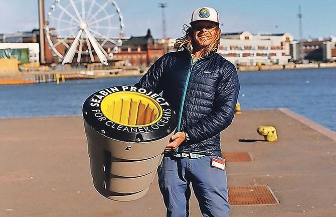 Pete Ceglinski, Seabin co-founder and CEO, holding an ocean plastic removal device © Seabin